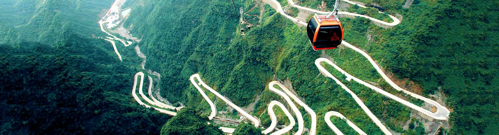 Take Cable Car Ride to Catch the Thrilling 99 Bends at Tianmen Mountain